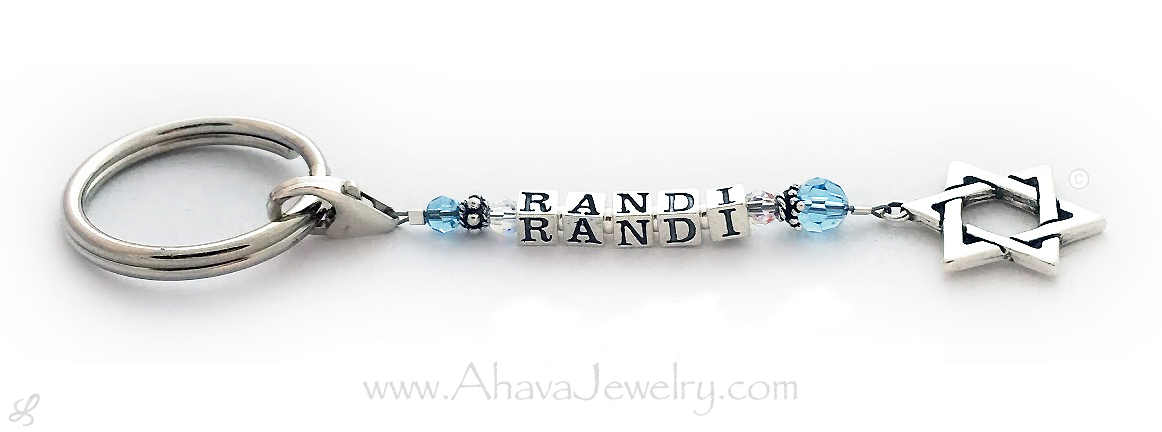 This key chain is shown with 1 Name, Randi, March or Aquamarine Swarovski crystals and a Star of David charm.